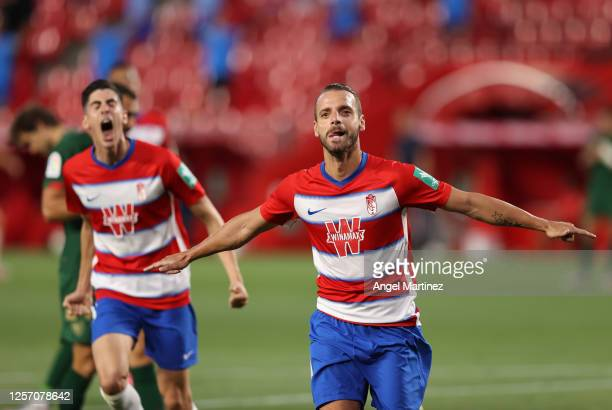 Roberto Soldado of Granada celebrates after he scores his sides first goal during the Liga match between Granada CF and Athletic Club at Nuevo Los...