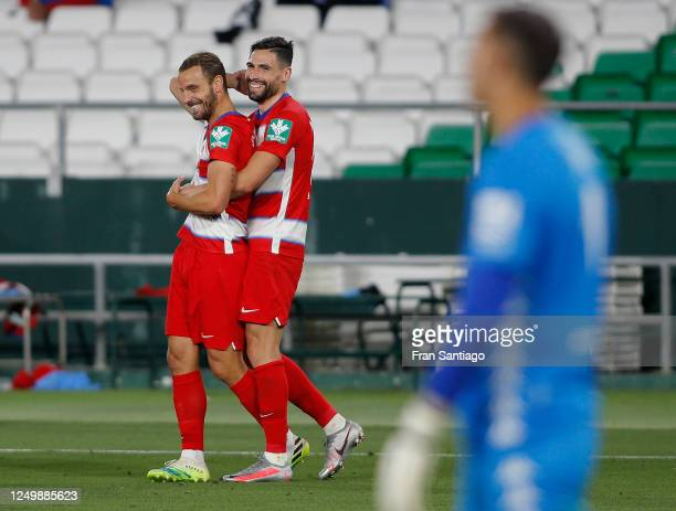 Roberto Soldado of Granada celebrates his late goal with team mate Antonio Puertas during the Liga match between Real Betis Balompie and Granada CF...