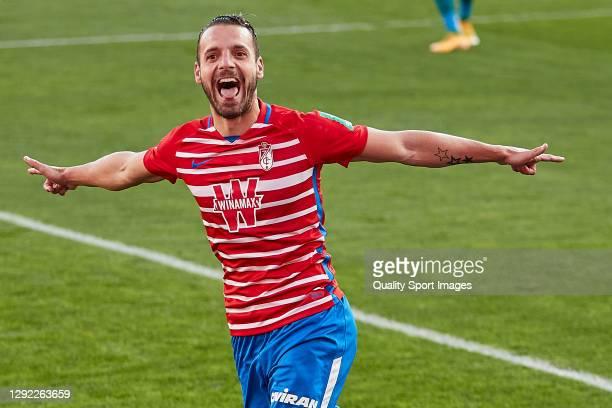 Roberto Soldado of Granada CF celebrates after scoring his team's second goal during the La Liga Santander match between Granada CF and Real Betis at...