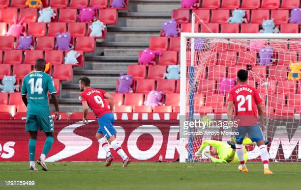 Roberto Soldado of Granada CF celebrates after scoring their sides first goal from the penalty spot during the La Liga Santander match between...