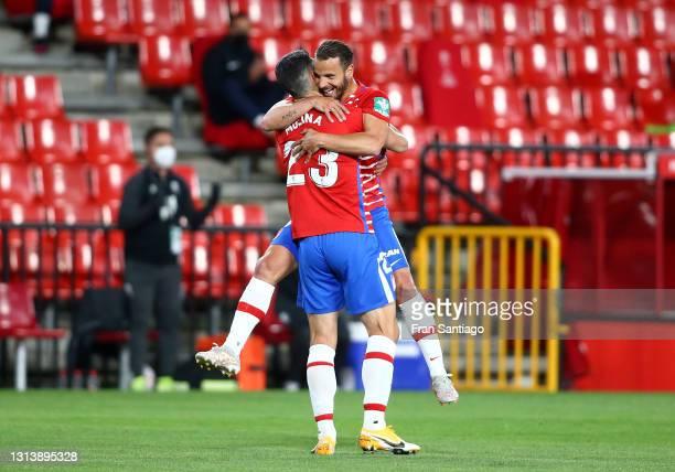 Roberto Soldado of Granada CF celebrates after scoring their sides first goal with team mate Jorge Molina during the La Liga Santander match between...