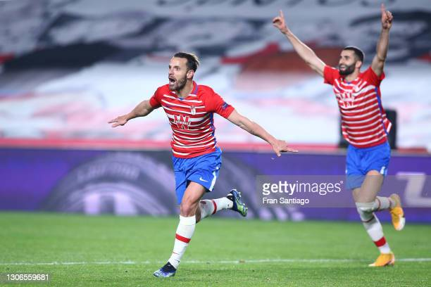 Roberto Soldado of Granada CF celebrates after scoring their team's second goal during the UEFA Europa League Round of 16 First Leg match between...