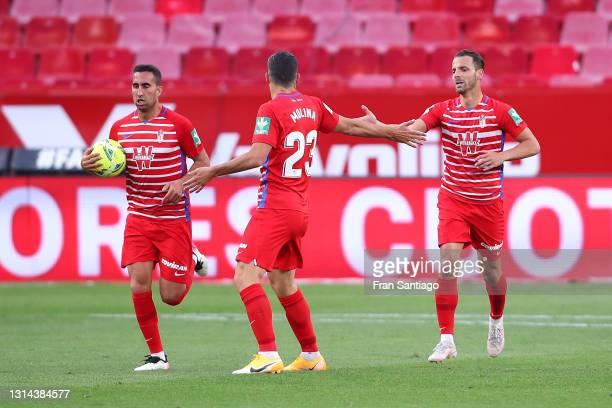 Roberto Soldado of Granada CF celebrates after scoring their team's first goal with Jorge Molina during the La Liga Santander match between Sevilla...