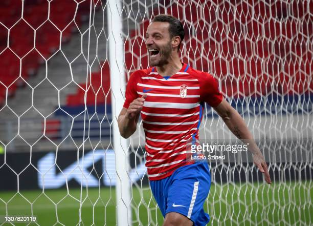 Roberto Soldado of Granada CF celebrates his goal during the UEFA Europa League Round of 16 Second Leg match between Molde and Granada at Puskas...
