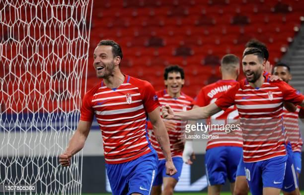Roberto Soldado of Granada CF celebrates his goal with teammates during the UEFA Europa League Round of 16 Second Leg match between Molde and Granada...