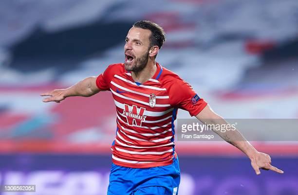 Roberto Soldado of Granada CF celebrates scoring a goal during the UEFA Europa League Round of 16 First Leg match between Granada and Molde at...