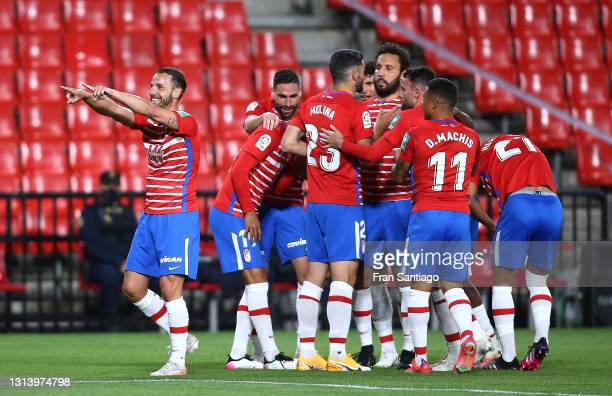 Roberto Soldado of Granada CF celebrates scoring a goal with team mates during the La Liga Santander match between Granada CF and SD Eibar at Estadio...
