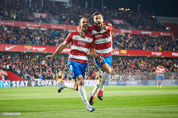 Roberto Soldado of Granada CF celebrates scoring his team's opening goal with Alvaro Vadillo during the Copa del Rey quarter final match between...