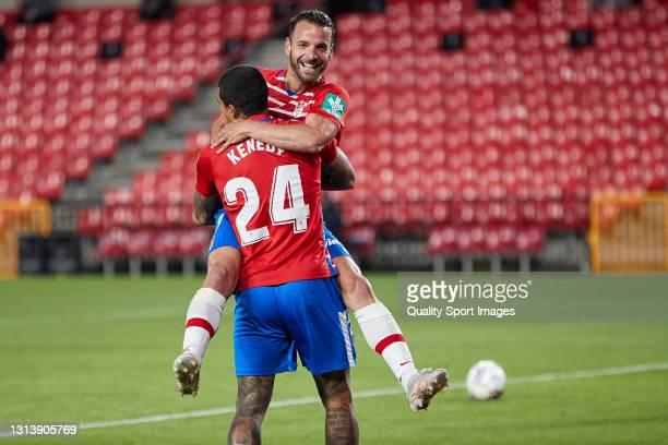 Roberto Soldado of Granada CF celebrates with his team mate Robert Kenedy after scoring his team's third goal during the La Liga Santander match...