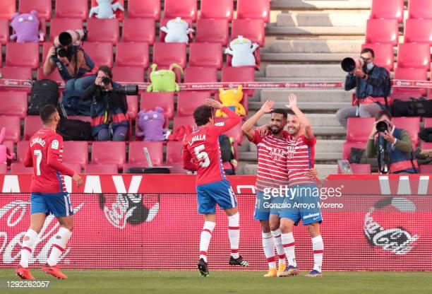 Roberto Soldado of Granada CF celebrates with team mates Yangel Herrera and Luis Milla after scoring their sides second goal during the La Liga...