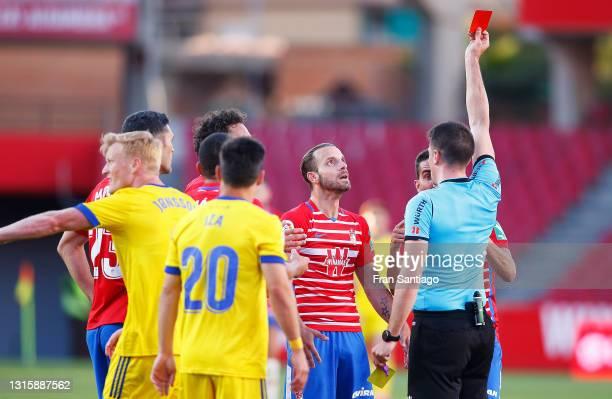 Roberto Soldado of Granada CF receives a red card during the La Liga Santander match between Granada CF and Cadiz CF at Estadio Nuevo Los Carmenes on...