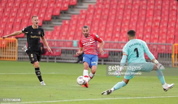 Roberto Soldado of Granada CF scores his team's first goal during the La Liga Santander match between Granada CF and Deportivo Alaves at Estadio...