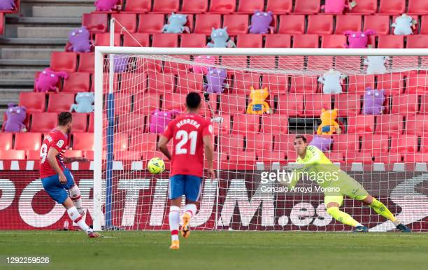 Roberto Soldado of Granada CF scores their sides first goal from the penalty spot past Joel Robles of Real Betis during the La Liga Santander match...