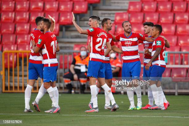 Roberto Soldado of Granada FC celebrates with teammates after scoring his sides first goal during the Liga match between Granada CF and SD Eibar SAD...