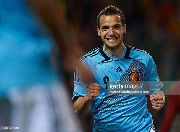 Roberto Soldado of Spain celebrates after scoring during the international friendly match between Spain and Venezuela at La Rosaleda Stadium on...