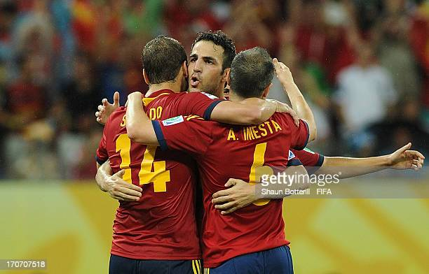 Roberto Soldado of Spain celebrates with Cesc Fabregas and Andres Iniesta as he scores their second goal during the FIFA Confederations Cup Brazil...