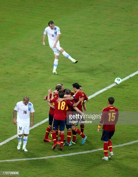 Roberto Soldado of Spain celebrates with team mates as he scores their second goal during the FIFA Confederations Cup Brazil 2013 Group B match...