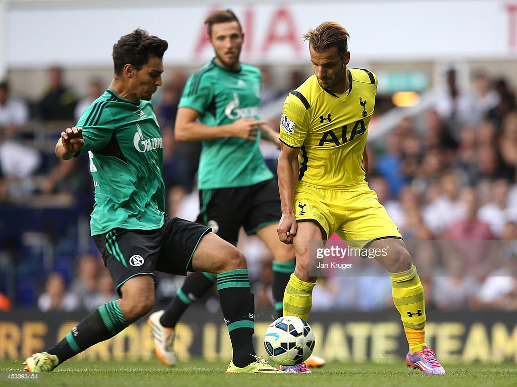 Roberto Soldado (R) of Spurs battles with Kaan Ayhan of Schalke during a pre season friendly match between Tottenham Hotspur and FC Schalke at White Hart Lane on August 9, 2014 in London, England.