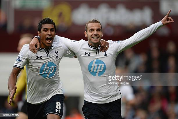 Roberto Soldado of Spurs celebrates scoring their second goal with Paulinho of Spurs during the Barclays Premier League match between Aston Villa and...