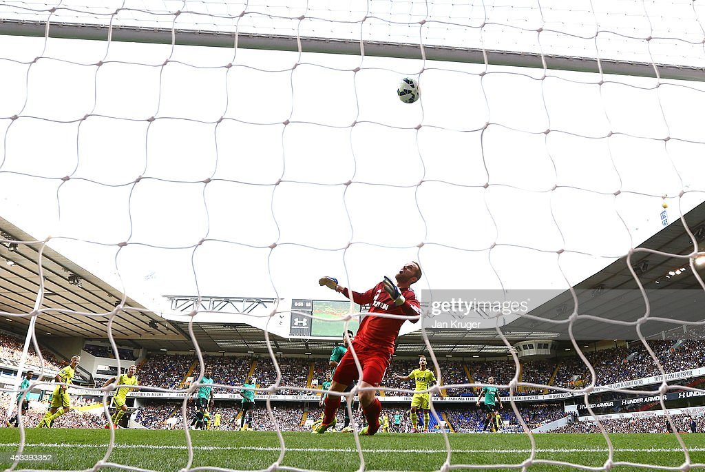 Roberto Soldado (2nd R) of Spurs heads the ball past Ralf Fahrmann of Schalke for his goal during a pre season friendly match between Tottenham Hotspur and FC Schalke at White Hart Lane on August 9, 2014 in London, England.