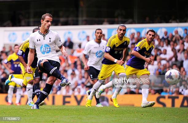 Roberto Soldado of Spurs scores the opening goal from the penalty spot during the Barclays Premier League match between Tottenham Hotspur and Swansea...