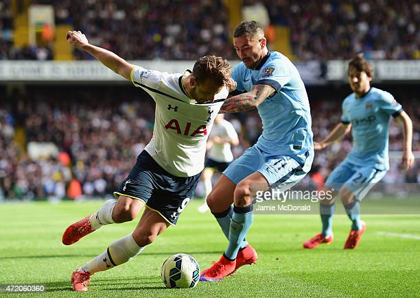 Roberto Soldado of Spurs tussles with Aleksandar Kolarov of Manchester City during the Barclays Premier League match between Tottenham Hotspur and...