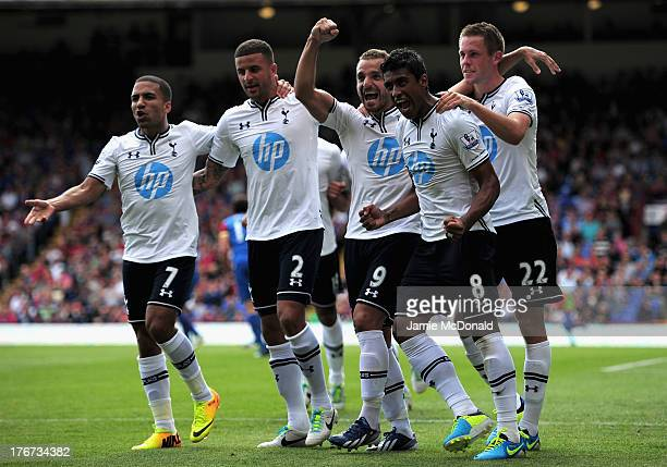 Roberto Soldado of Tottenham Hotspur celebrates scoring from the penalty spot with team mates Aaron Lennon Kyle Walker Paulinho and Gylfi Sigurdsson...