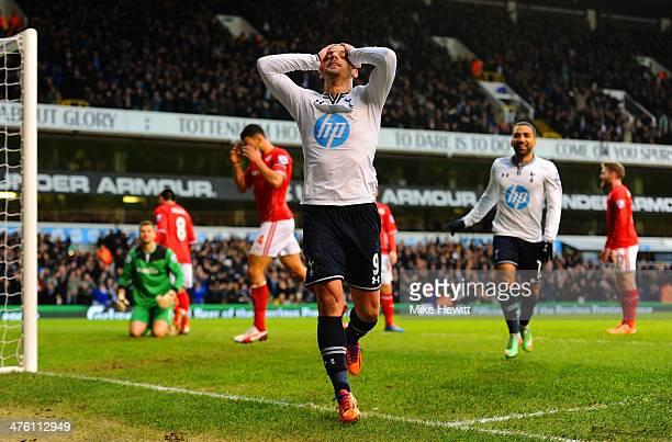 Roberto Soldado of Tottenham Hotspur celebrates scoring the opening goal during the Barclays Premier League match between Tottenham Hotspur and...