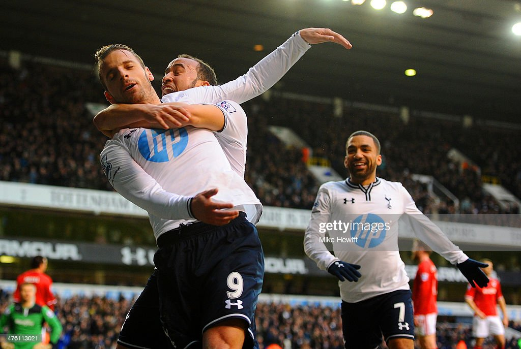 Roberto Soldado of Tottenham Hotspur celebrates scoring the opening goal with Andros Townsend and Aaron Lennon of Tottenham Hotspur during the Barclays Premier League match between Tottenham Hotspur and Cardiff City at White Hart Lane on March 2, 2014 in London, England.