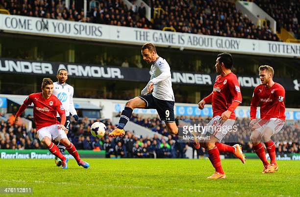 Roberto Soldado of Tottenham Hotspur scores the opening goal during the Barclays Premier League match between Tottenham Hotspur and Cardiff City at...