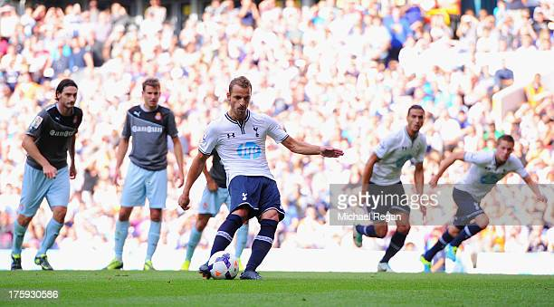 Roberto Soldado of Tottenham scores a penalty to make it 1-0 during a pre season friendly match between Tottenham Hotspur and Espanyol at White Hart...