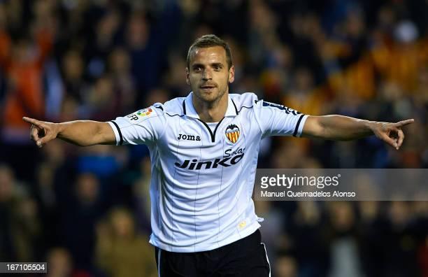 Roberto Soldado of Valencia celebrates after scoring the second goal during the La Liga match between Valencia CF and Malaga CF at Estadio Mestalla...
