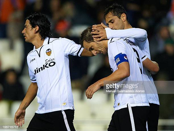 Roberto Soldado of Valencia celebrates with his teammates Jonas and Tino Costa after scoring his team's second goal during the UEFA Champions League...