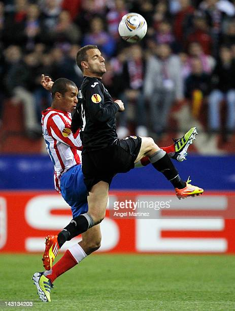 Roberto Soldado of Valencia duels for the ball with Joao Miranda of Atletico Madrid during the UEFA Europa League Semi Final first leg match between...