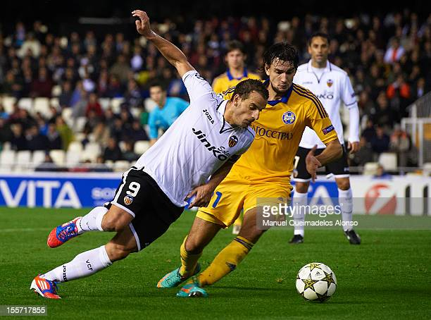 Roberto Soldado of Valencia duels for the ball with Yegor Filipenko of BATE Borisov during the UEFA Champions League group F match between Valencia...