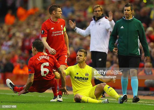 Roberto Soldado of Villarreal and Dejan Lovren of Liverpool clash during the UEFA Europa League semi final second leg match between Liverpool and...