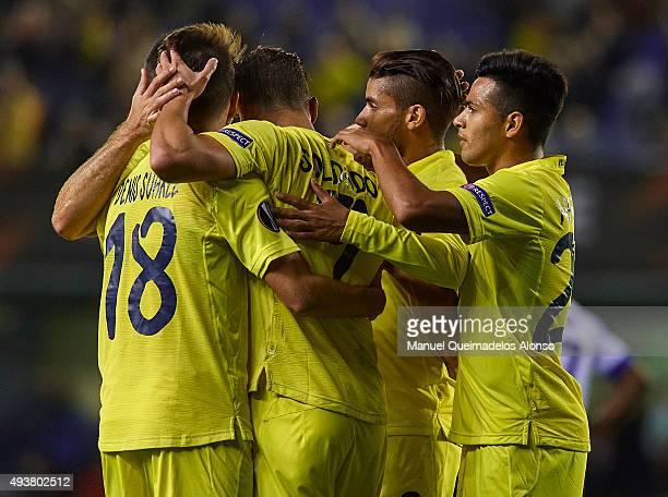 Roberto Soldado of Villarreal celebrates scoring his team's third goal with his teammates during the UEFA Europa League Group K match between...