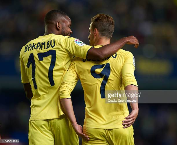 Roberto Soldado of Villarreal celebrates with Cedric Bakambu of Villarreal after scoring the first goal during the La Liga match between Villarreal...