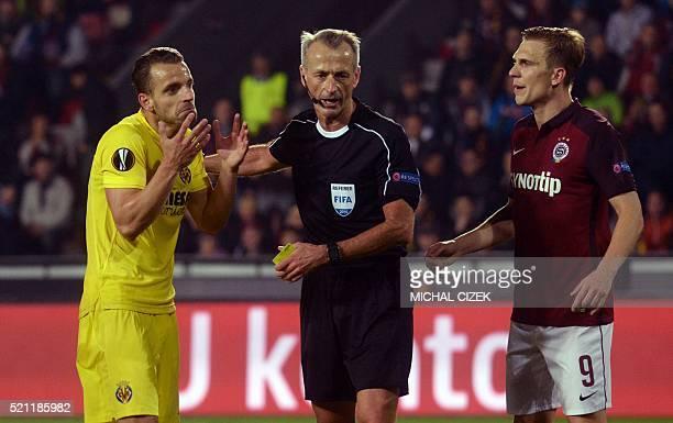 Roberto Soldado of Villarreal CF argues with referee Martin Atkinson during the UEFA Europa League quarterfinal second leg football match AC Sparta...