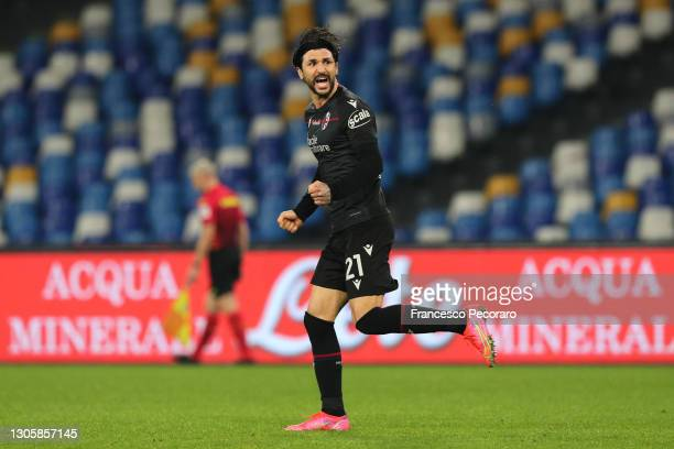 Roberto Soriano of Bologna F.C. 1909 celebrates after scoring their side's first goal during the Serie A match between SSC Napoli and Bologna FC at...