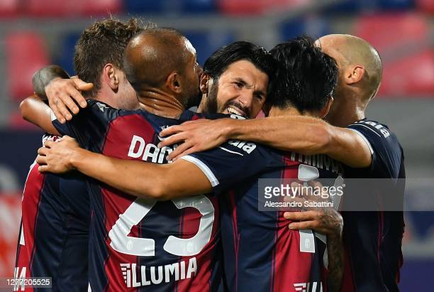 Roberto Soriano of Bologna FC celebrates after scoring the opening goal with teammates during the Serie A match between Bologna FC and Parma Calcio...