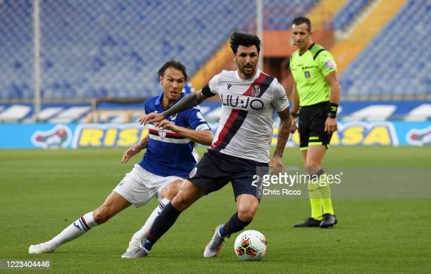 Roberto Soriano of Bologna FC evades challenge from Albin Ekdal of UC Sampdoria during the Serie A match between UC Sampdoria and Bologna FC at...