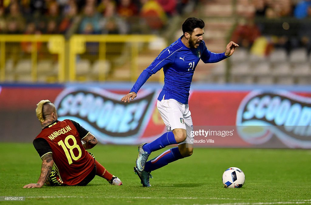 Roberto Soriano of Italy and Radja Nainggolan of Belgium #18 compete for the ball during the intermational friendly match between Belgium and Italy at King Baudouin Stadium on November 13, 2015 in Brussels, Belgium.