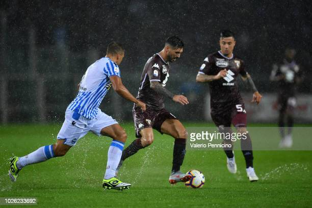 Roberto Soriano of Torino FC in action against Thiago Cionek of SPAL during the Serie A match between Torino FC and SPAL at Stadio Olimpico di Torino...