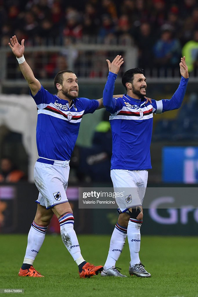 Roberto Soriano (R) of UC Sampdoria celebrates after scoring the opening goal with team mate Lorenzo De Silvestri during the Serie A match between Genoa CFC and UC Sampdoria at Stadio Luigi Ferraris on January 5, 2016 in Genoa, Italy.