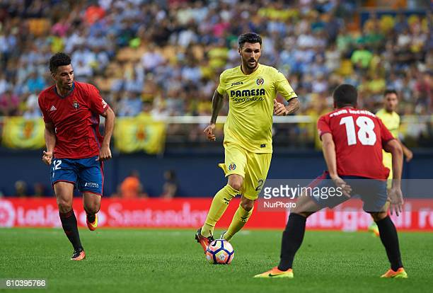 Roberto Soriano of Villarreal CF and Riviere of Club Atletico Osasuna in action during the La Liga match between Villarreal CF vs Club Atletico...