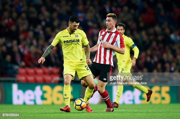 Roberto Soriano of Villarreal CF competes for the ball with Aymeric Laporte of Athletic Club during the La Liga match between Athletic Club Bilbao...
