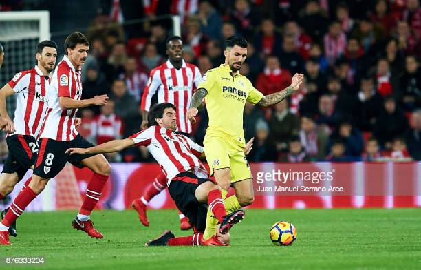 Roberto Soriano of Villarreal CF competes for the ball with Mikel San Jose of Athletic Club during the La Liga match between Athletic Club Bilbao and...