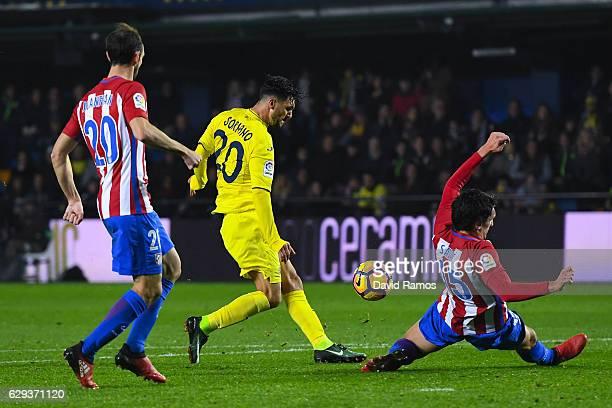 Roberto Soriano of Villarreal CF scores his team's third goal during the La Liga match between Villarreal CF and Club Atletico de Madrid at El...