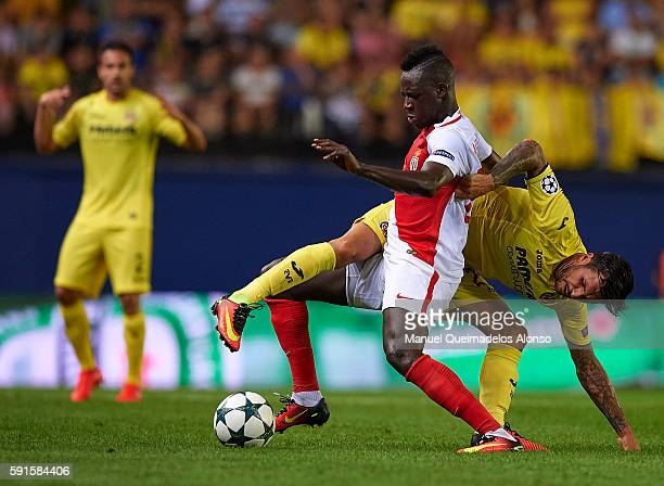 Roberto Soriano of Villarreal competes for the ball with Tiemoue Bakayoko of Monaco during the UEFA Champions League playoff first leg match between...